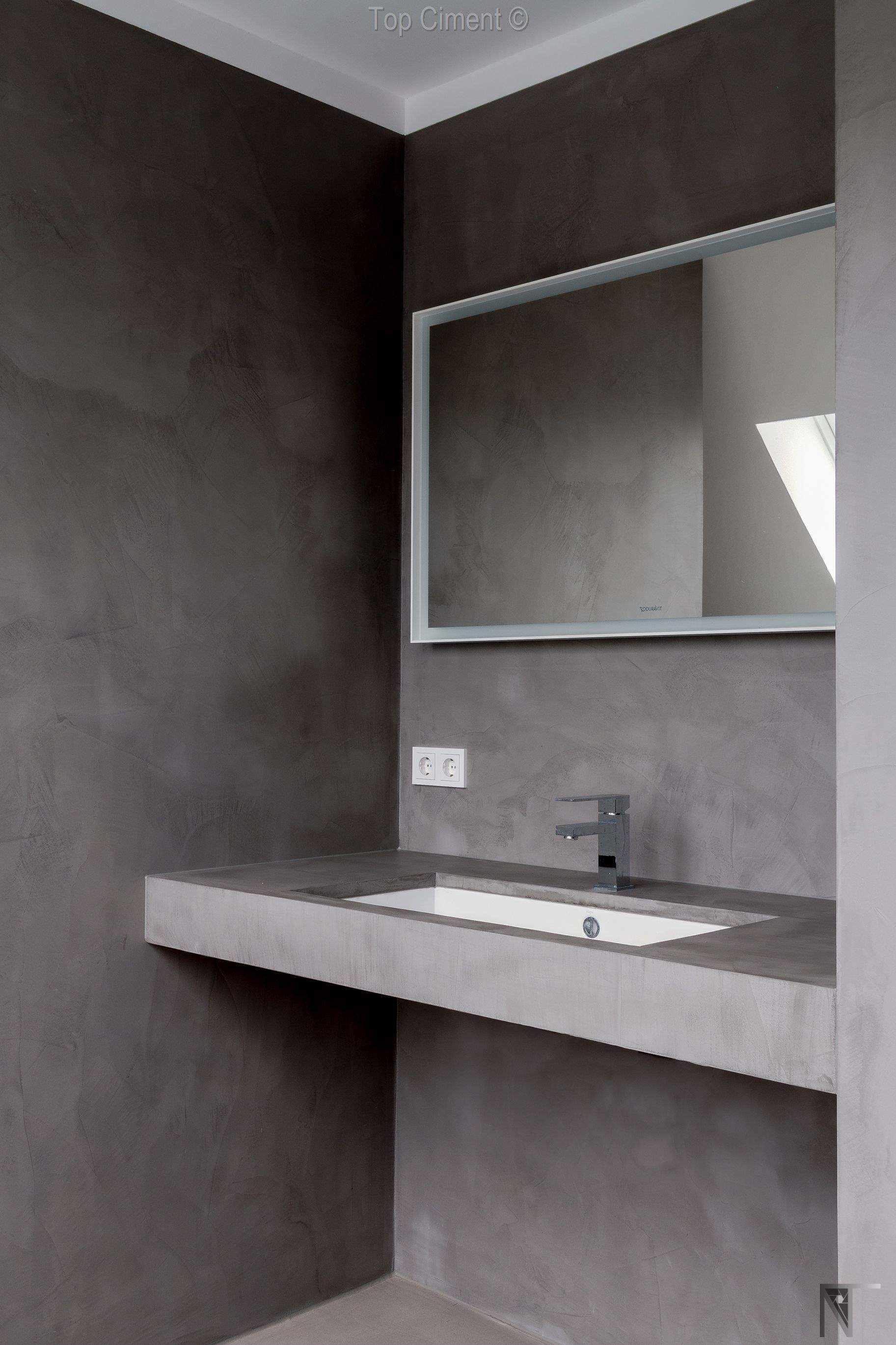 Paredes de microcemento gris en cuartos de baño