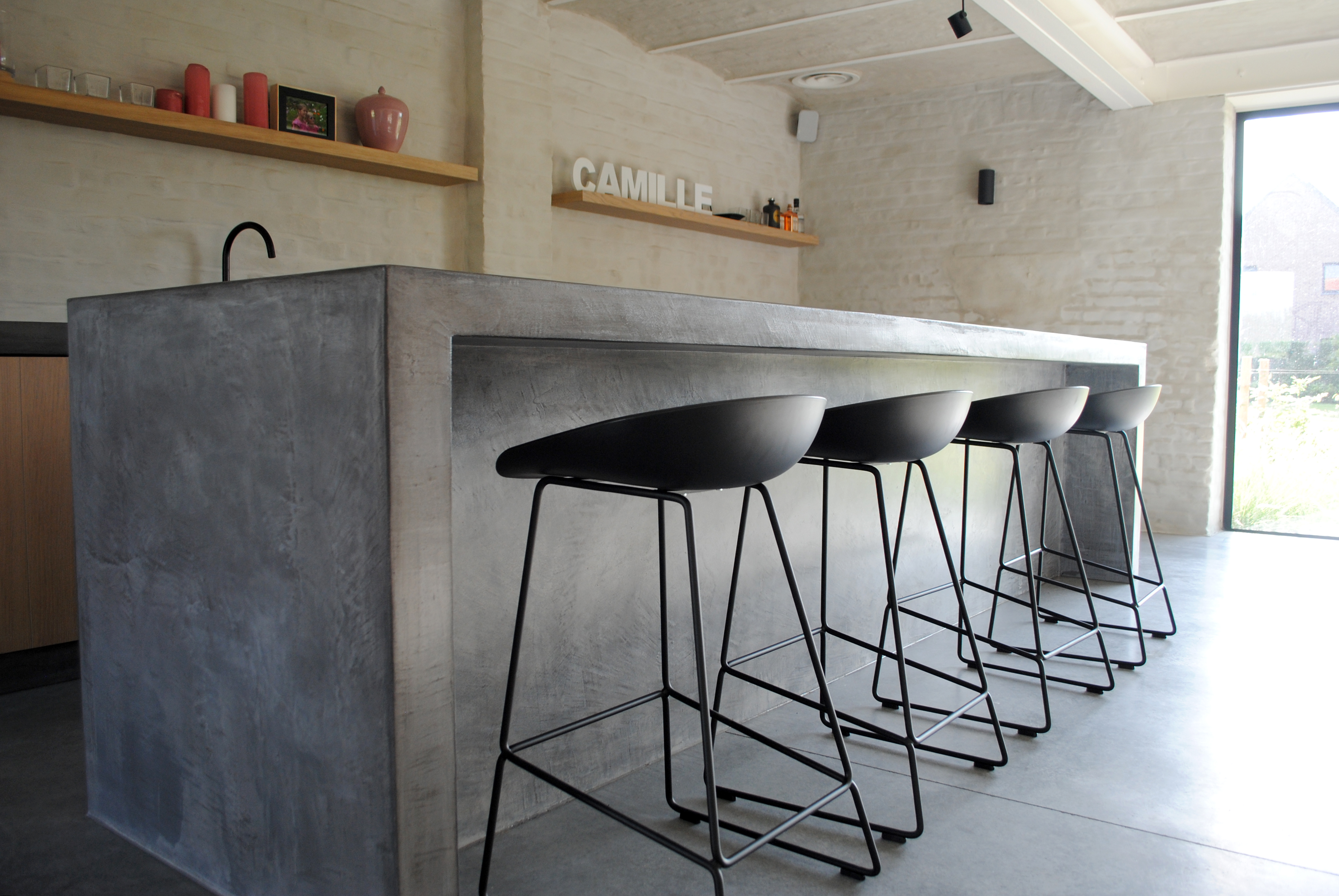 Grey microcement kitchen open to the living room
