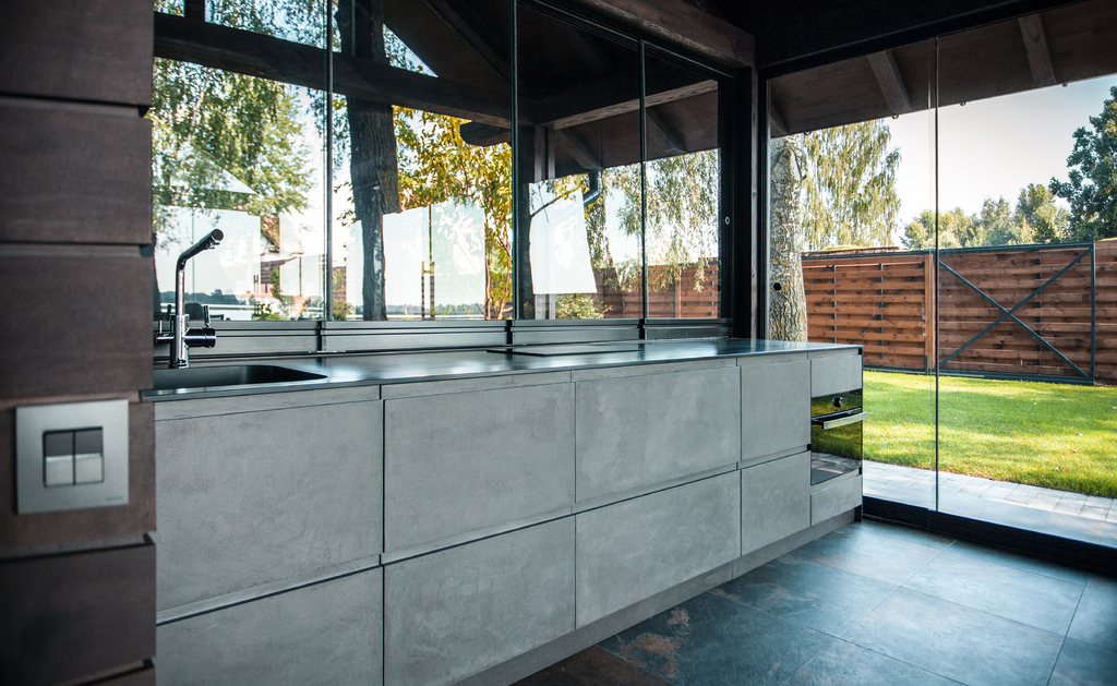 Grey microcement kitchen with two fronts