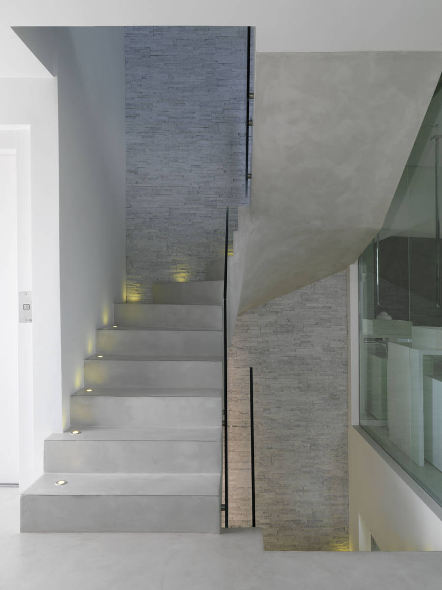 open interior microcement staircase with one wall