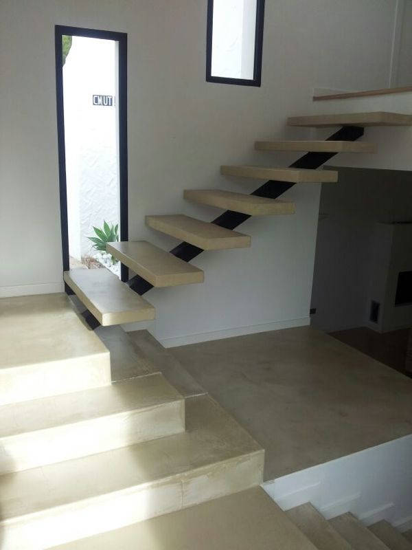 interior microcement staircase with central support
